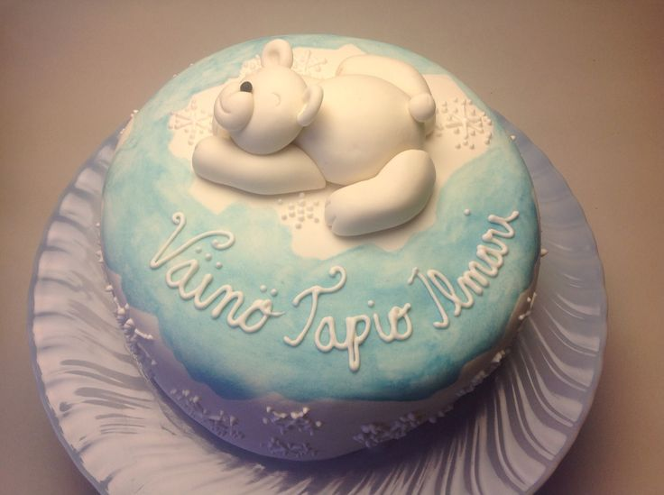 Polar bear cake for a baby boy. Sugar paste and royal icing.