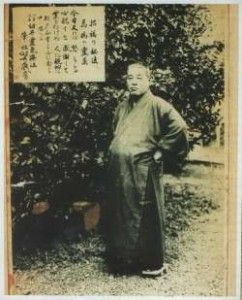 Mikao Usui, founder of Usui Reiki Ryoho, standing on front of the Five Reiki Principles
