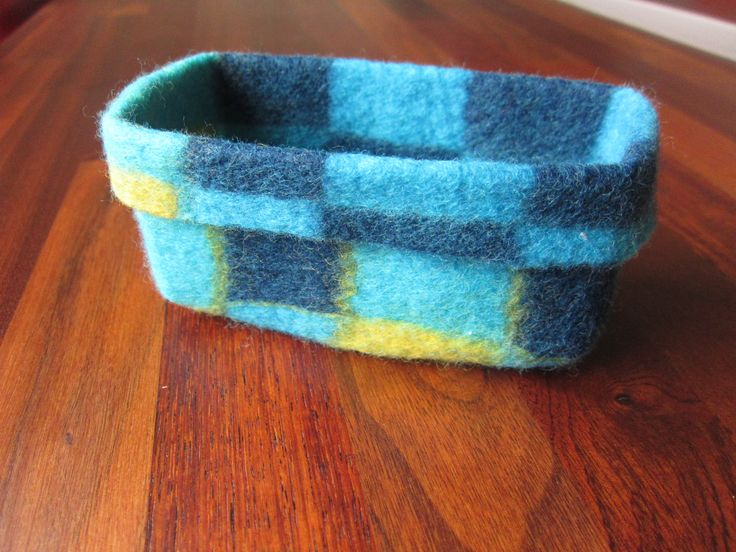 Small checkered felted basket made by Marjo Lelie