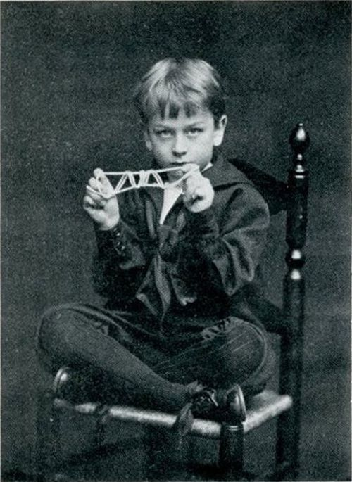 Child with string figure