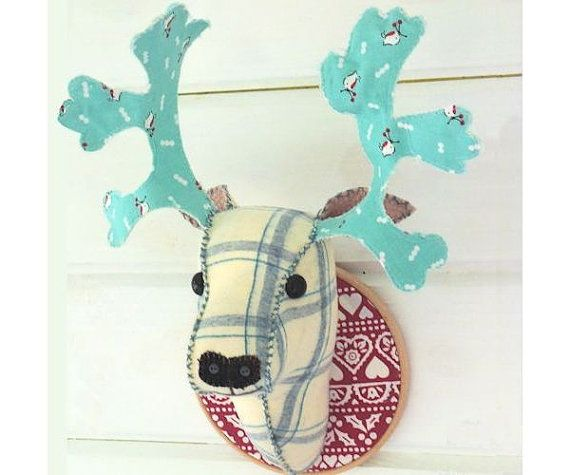 """This little deer is looking remarkably cheerful, he's mounted on a 6"""" hoop and measures 14"""" from the bottom of his neck to the tips of his antlers."""