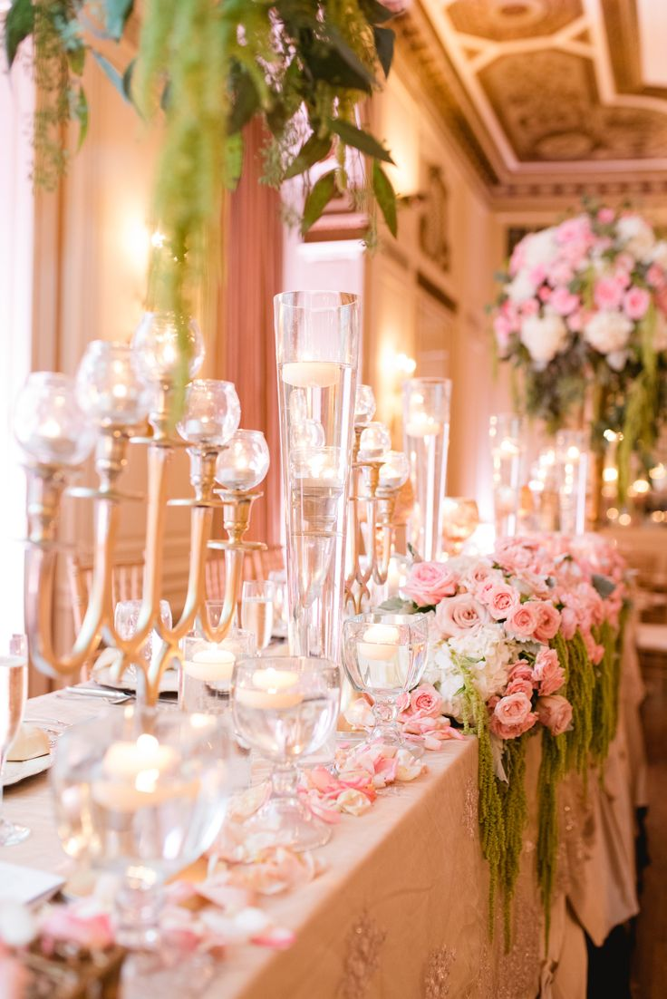 elegant and over the top gold and pink wedding reception table for the wedding party