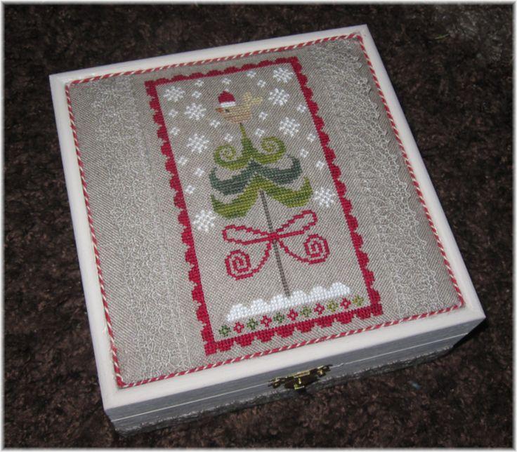 Cross stitch finished into a box