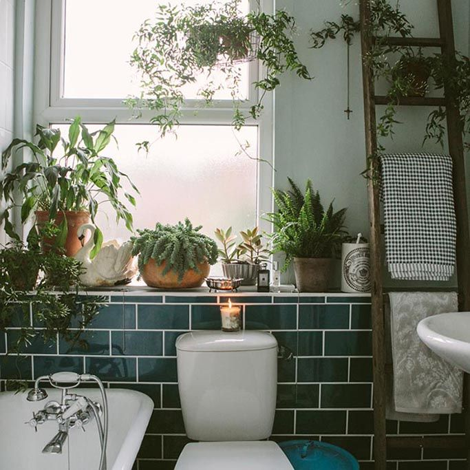 Great use of dark green subway tiles in the bathroom // add some colour to your bathrooming!!