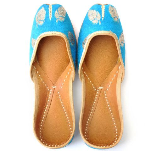 Known as the color of serenity, blue is an all time favourite and this pair of sky blue punjabi juttis decorated with silver leaf pattern is sure to strike a elegantly serene chord. Adorn it elegantly both with formal and casual wear. Description Handmade Regular Wear Women Mojari (Punjabi Jutti/women's footwear) in Leather with premium European fabric Work – Leather with Blue and Golden Fabric Material : Leather (Safe for skin) Care Instructions : Clean with Soft brush