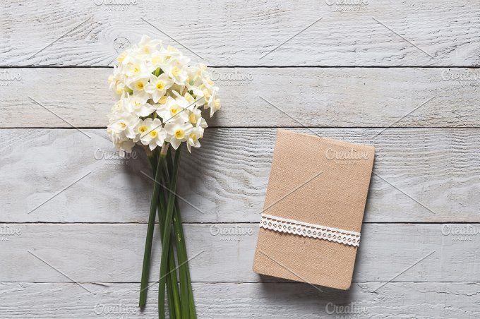 White narcissus flowers and notebook by Irantzu Arbaizagoitia on @creativemarket