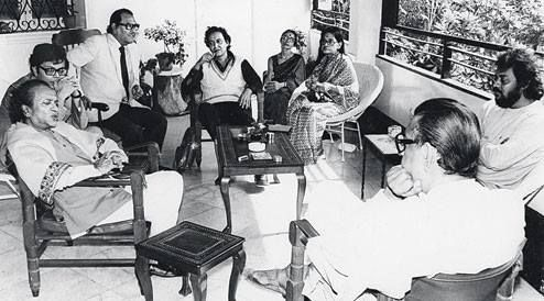 Calcutta - early 80s. Ravi Shankar, the sitar maestro had come to visit Satyajit Ray (back to camera), who was recovering from a heart attack. At the far end are actor Soumitra Chatterjee and Ray's wife, Bijoya Ray (picture by Nemai Ghosh)