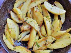Patate arrosto all'aglio, prezzemolo, peperoncino