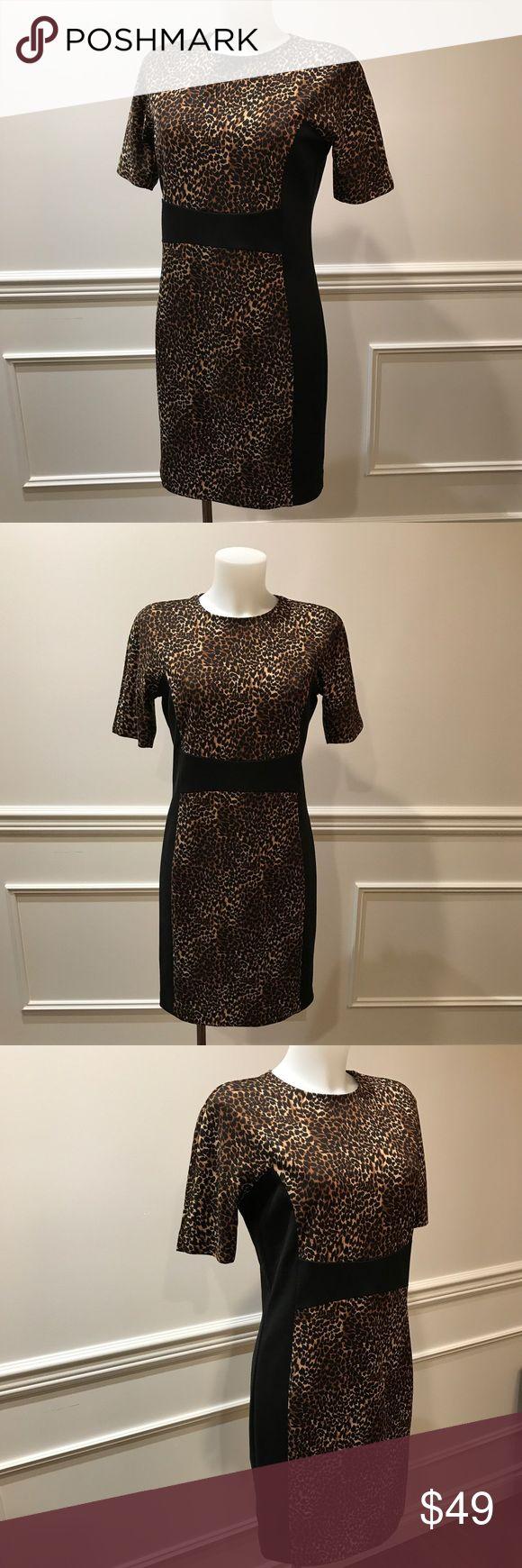 Animal print Michael Kors mini dress. Classic animal print Michael Kors  zip up the back mini dress. MICHAEL Michael Kors Dresses Mini
