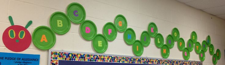Each preschooler picks a plate and then verbally identifies the letter they chose (letters of the alphabet are glued onto dollar tree green plates). We work together to put our Hungry Caterpillar in alphabetical order. It is then proudly displayed above our bulletin board.