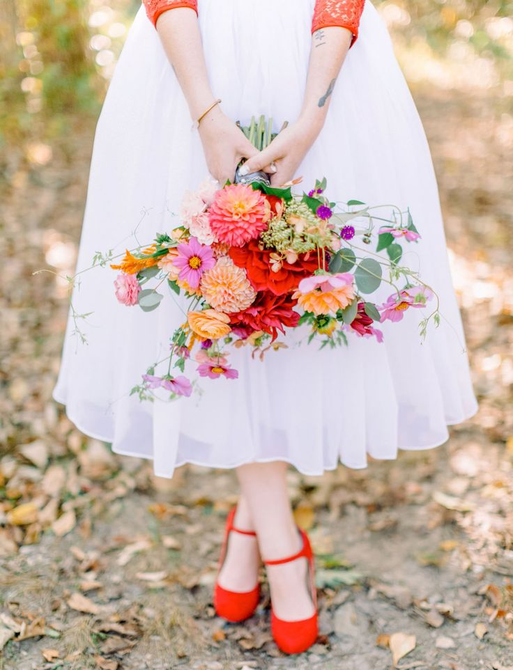 Red heels and colorful bouquet