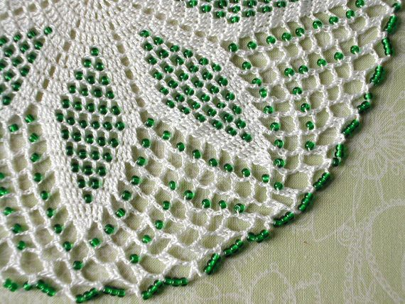 White crochet lace doily / center piece with green glass beads via Etsy