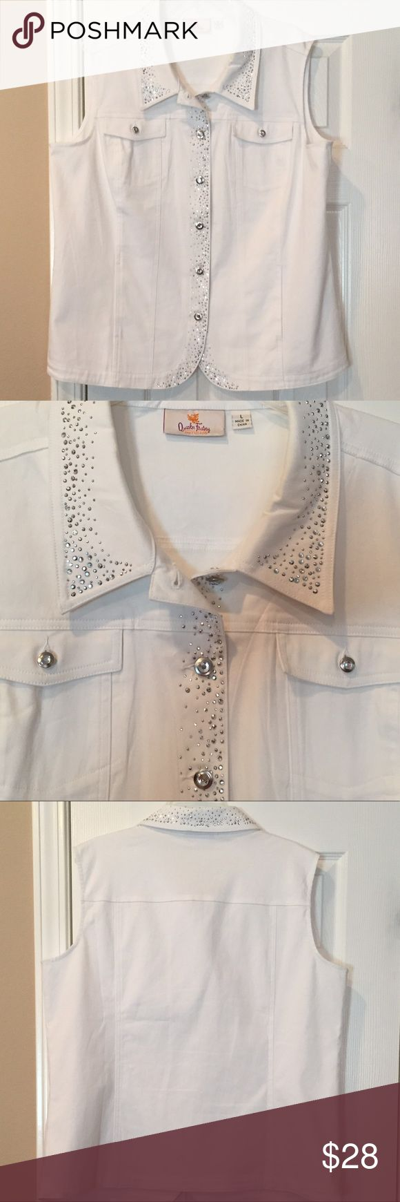 DreamJeannes White Denim Vest Classic jean vest with a twist! Rhinestone embellishments- semi fitted; follows the lines of the body with added wearing ease. Collar rhinestone button front closure, seaming rhinestone detail, two functional chest pockets with rhinestone button closure. Made of 97% Cotton 3% Spandex. Excellent condition! (No rips, stains or tears). Quacker Factory Tops Button Down Shirts