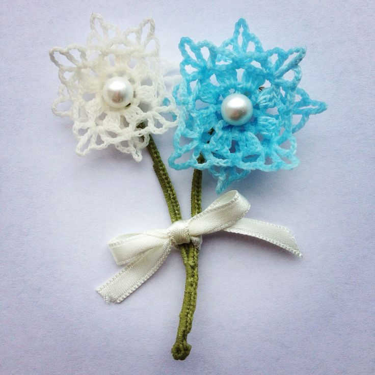 Something blue. Lace brooch in ivory & blue threads with crochet green stem. www.etsy.com/people/hookcrochet