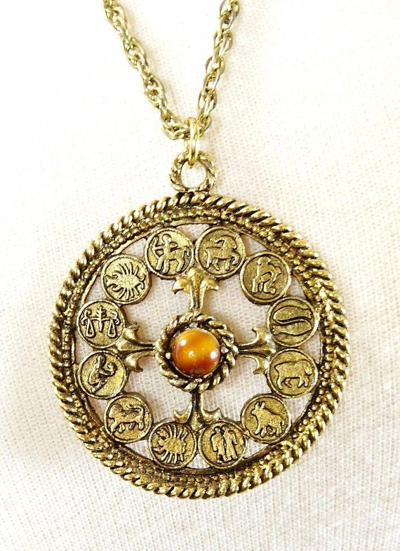 Beautiful vintage necklace with a beautiful round zodiac. #adoredblessings