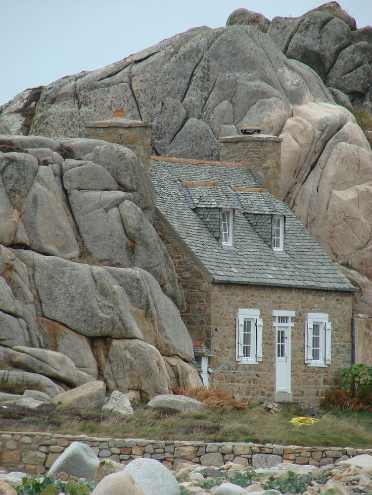 Petite maison de Plougrescant, Brittany, France ~ built into a large rock formation which has protected it from the violent winds of the sea since 1861.