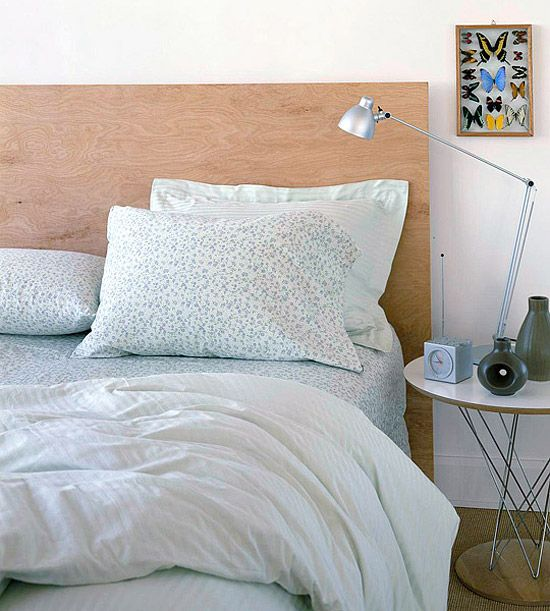 Make this ultramodern headboard in an hour. Buy a piece of plywood from your local home supply store. Sand it, stain it, seal it, then set it behind your bed. The clean lines will help you sleep in style.