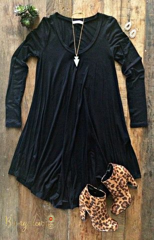 Ultra-comfortable T-shirt dress. Full-sleeve. Swing fit with a V-neck. Dress measures slightly shorter on the sides than the front. 95% Rayon 5% Spandex. Shown with the Endora Booties. Modeled in Char