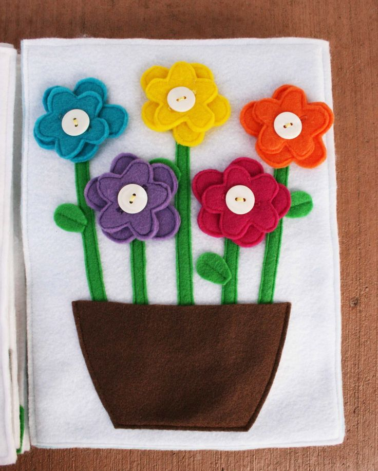 Flower pot - double flowers with button holes.  Pot is open to store flowers