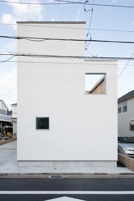 Yuji Kimura Design conceals terraces at House K behind a tall wall
