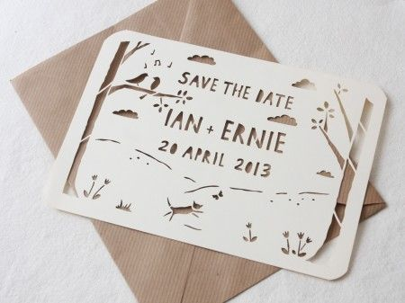 Save the date paper cut card. Place picture behind it. So cool.