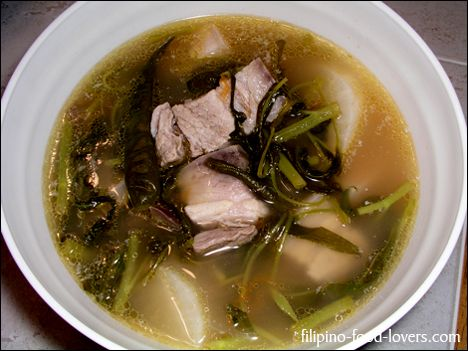 Pork Sinigang is a Filipino comfort food.  Its a very unique flavor made using tamarind. There are many variations...i just use pork and mustard greens because that's how my grandma always made it :)  Incredibly easy to prepare!
