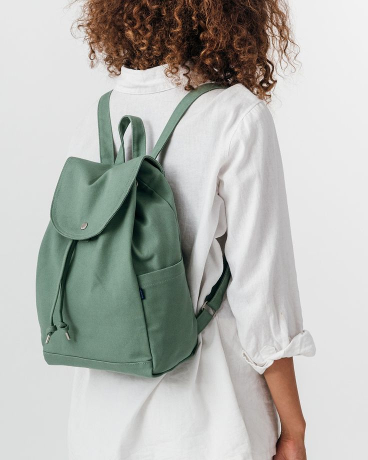 A simple canvas satchel for daily essentials. Roomy, but still neatly sized. **** 10.5 in. W x 15 in. H x 5 in. D.Two adjustable straps.One interior and two ext