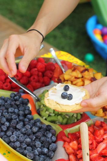 Fruit pizza with cream cheese frosting. A great food idea for showers, birthdays, or any large group gathering.