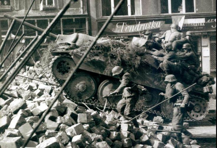 A Hetzer navigates rubble in the streets with Waffen SS units in Prague during early 1945