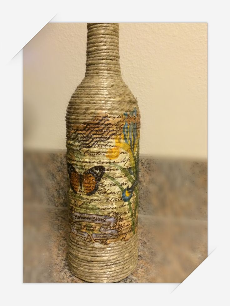 Hemp twine wrapped wine bottle. Modge podged napkin on the front