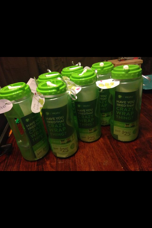 "Sports bottles with - Letter about ""it works"", blitz card, and berry greens on the go packet."