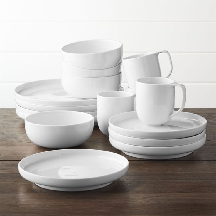 Shop Toben 16-Piece Dinnerware Set.  Crisp white porcelain dinnerware trends modern and flexible in modern, rounded coupe shapes perfectly at ease in casual and formal settings.  Low curves allow for easy stacking and space-saving storage.