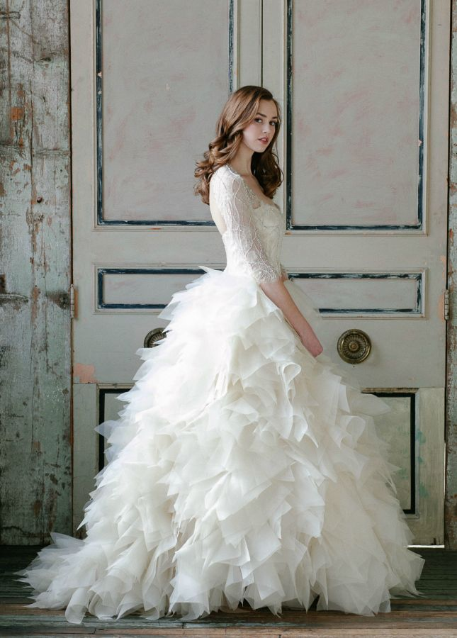 This three-quarter sleeve wedding dress with a ruffle skirt is a major standout.