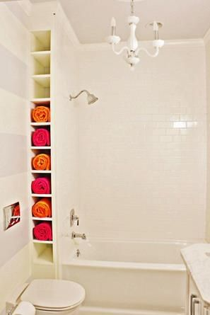 Put cubes for towels at the end and then have recessed areas in shower for shampoo and stuff