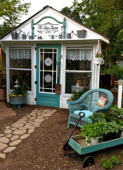 They started with a metal gazebo frame and using old windows and doors made this.   Ann's Lady Lounge