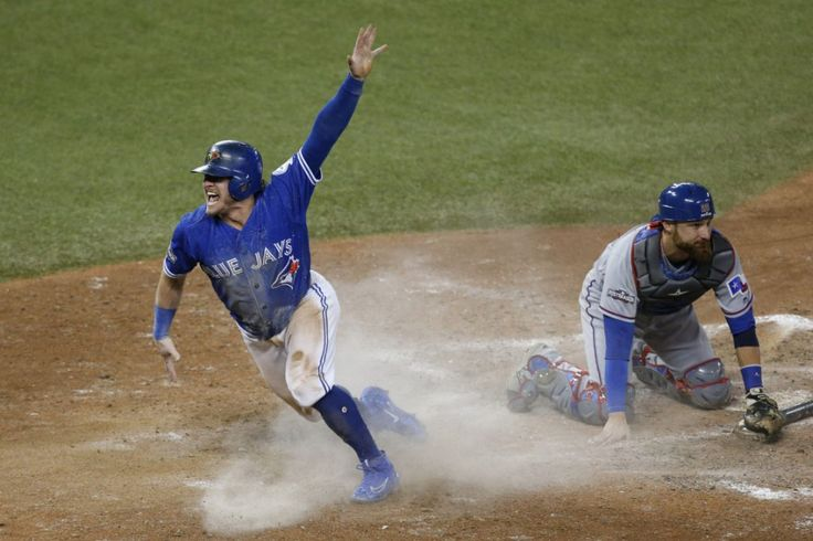 Josh Donaldson scores the winning run in the 10th inning in the Jays' 7-6 series-clinching victory over Texas on Sunday night. Oct 9, 2016