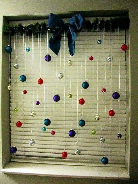 Here's an inexpensive way to decorate windows, a bit of garland at the top & hang bulbs at various lengths with ribbon. Pretty & Easy!