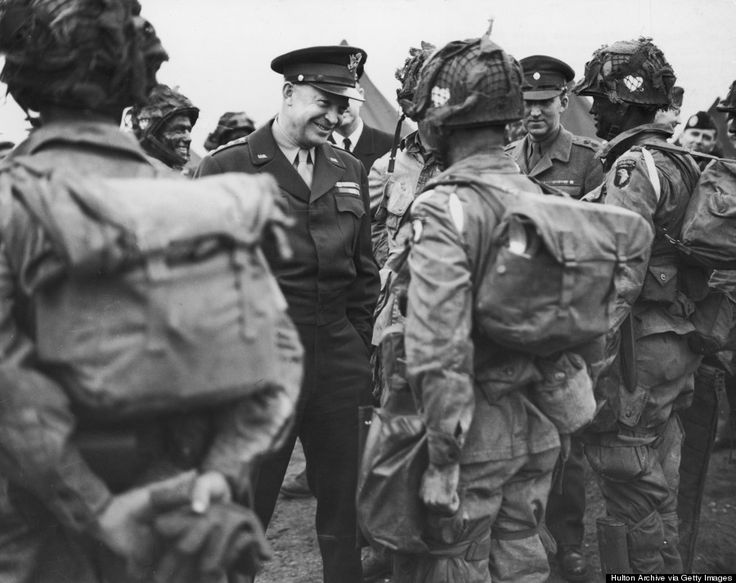 General Dwight D. Eisenhower (1890-1969) smiles while speaking with the men of the US 101st Airborne Division, 'The Screaming Eagles', as they prepare for the D-Day invasion, England, World War II, June 6, 1944. (Hulton Archive/Getty Images)