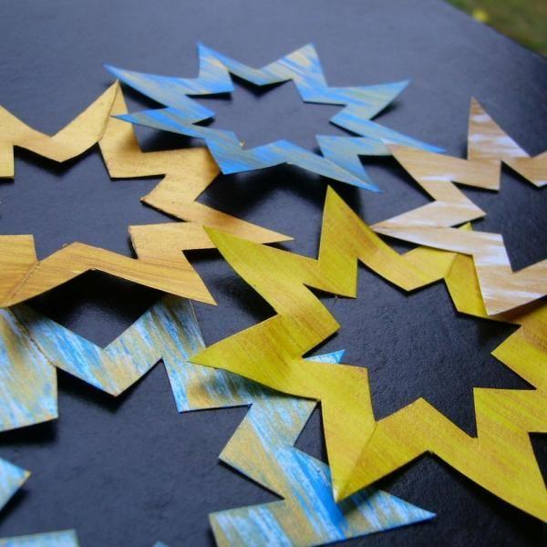 Como fazer uma estrela de Natal com cartolina - 9 passos
