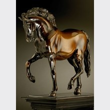 after a model by Giambologna  Walking Horse with Flowing Mane Bronze statuette, with remains of brown varnish 26.7 cm high