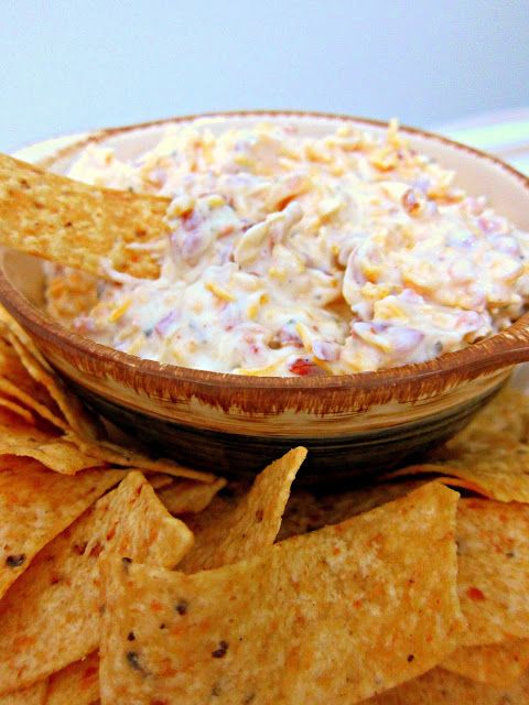 Cheddar Bacon Dip 16 oz sour cream 1 packet Ranch dressing mix 3 oz bacon bits (in the bag not jar) 1 cup shredded cheddar cheese  Mix together and refrigerate 24 hours. Serve with chips and/or veggies.