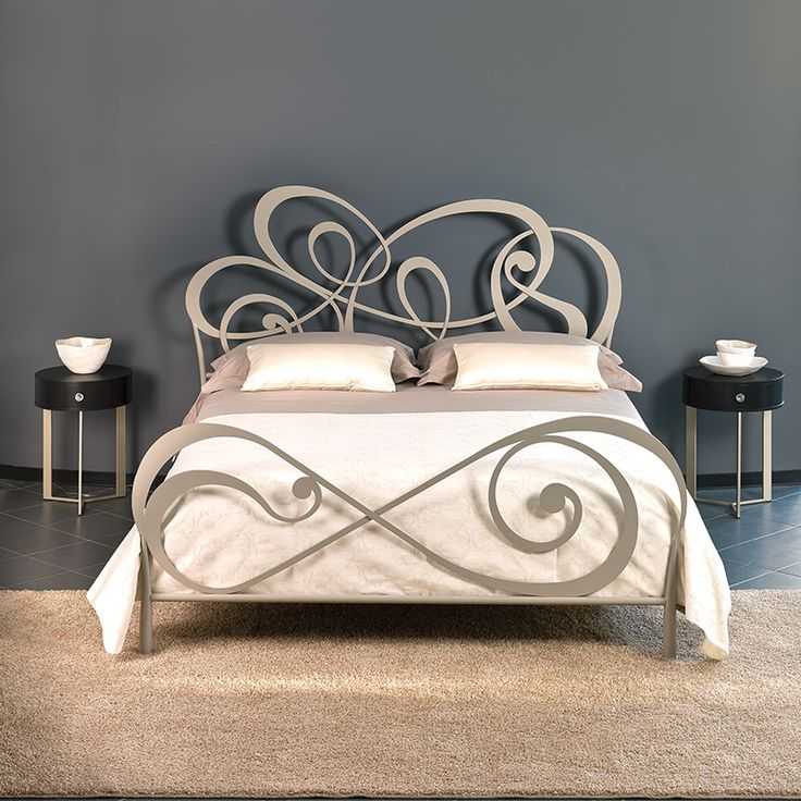 guest bedroom styling around an intricate wrought iron bed
