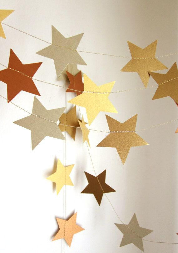 Your New Year's Eve color theme doesn't matter for this craft, according to Arts Delight. Whether you're glistening in gold or dancing in a variety of colors, you can dangle your star garland from up above this New Year's Eve. Which colors will you use?