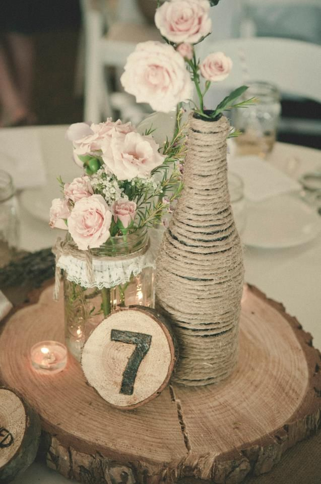 Vintage Burlap Centerpiece. Love the three different heights. Maybe a twine covered bottle (with actual sparkling cider for the toast!) mason jar full of white and creamy flowers and instead of a table number, a vintage looking frame big enough for a wallet size engagement photo!!