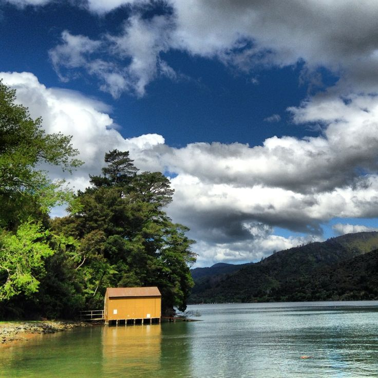 Yellow Boat Shed at Anakiwa in the Marlborough Sounds, New Zealand