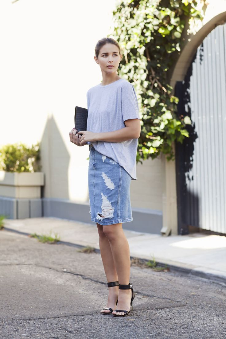 Sara in a grey tee, distressed denim skirt and ankle strap sandals #style #fashion #harperandharley