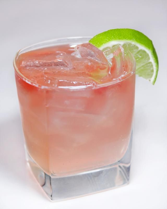 Cocktail recipe for a Sloe Gin Fizz, a classic drink of sloe gin, gin, lemon juice and simple syrup topped with soda.