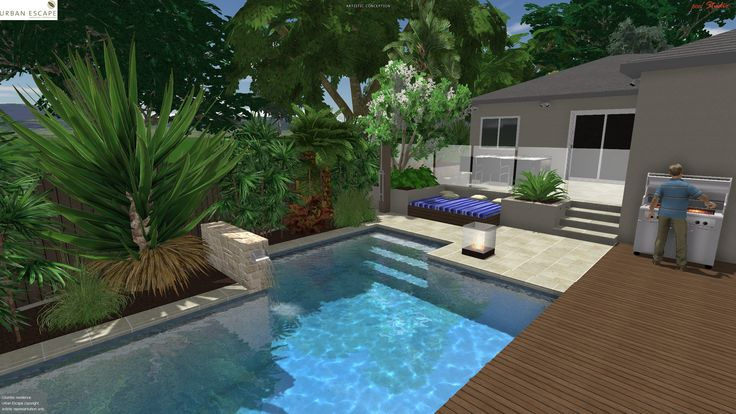 Pool w/ stone water feature pouring to pool, timber sun deck & daybed.