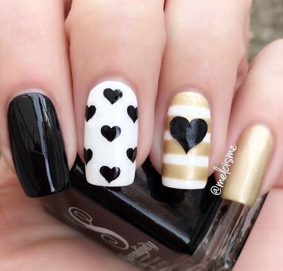 @melcisme is rocking this fabulous manicure using our Large Heart Nail Decals & Straight Nail Vinyls found at snailvinyls.com