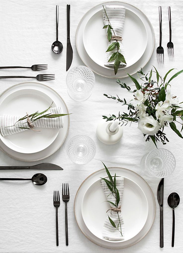 The gun metal flatware is brilliant on this modern black and white table!